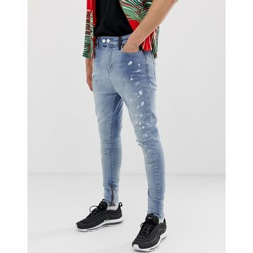 Religion drop crotch carrot fit jeans with zips in blue wash