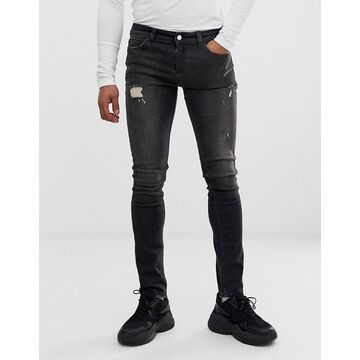 Religion skinny fit jeans with abrasions in washed black