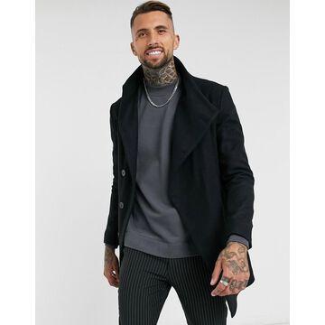 Religion asymmetrical funnel neck coat in black