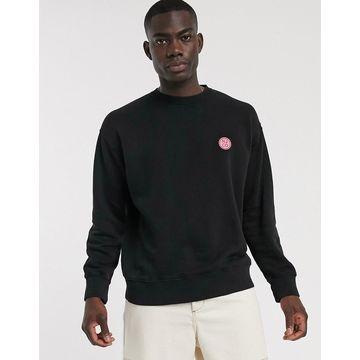 Nudie Jeans Lukas badge logo sweatshirt in black