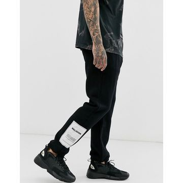 Religion sweatpants with patch detail in black