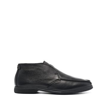 Institutional moccasin boots