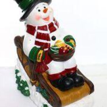 Alpine Corporation Outdoor Solar Snowman in Sleigh with LED Lights