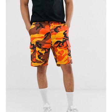 Reclaimed Vintage camo cargo shorts in orange