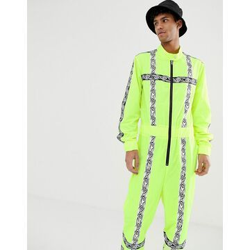 Jaded London festival boilersuit in neon yellow with reflective taping