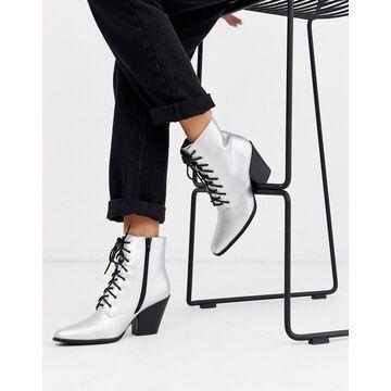 London Rebel heeled western boots in silver foil