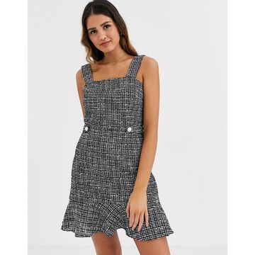Miss Selfridge boucle pinafore dress with frill hem in check-Black