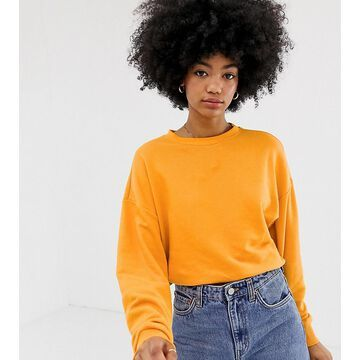 Weekday sweatshirt in orange melange