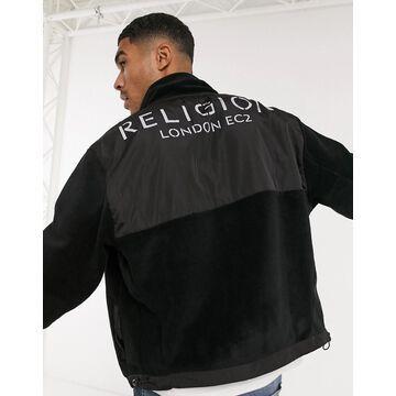 Religion zip through logo fleece in black