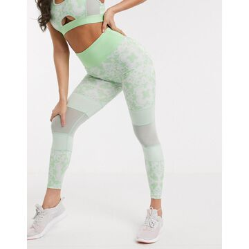 Wolf & Whistle Eco leggings in green geometric print with contrast panels