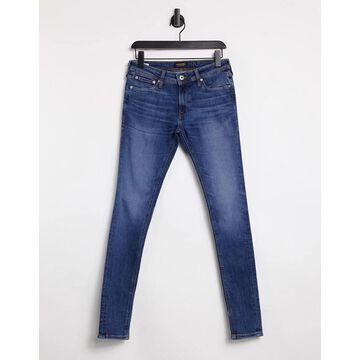 Jack & Jones Intelligence Tom spray on jeans in mid blue-Blues
