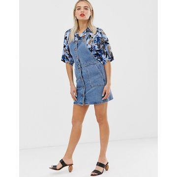 Monki mini denim overall dress in blue