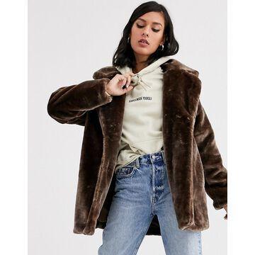 Monki short faux fur jacket in brown