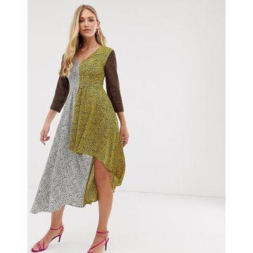Liquorish v neck dress with hi-low hem in mixed animal print