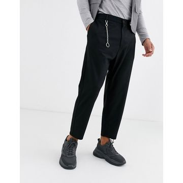 Bershka carrot fit pants with chain detail in black
