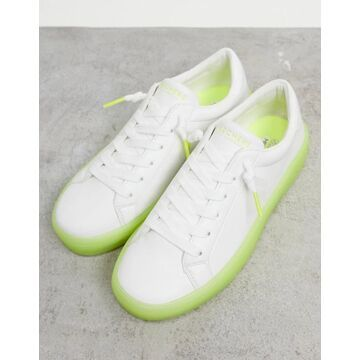 Skechers lace up sneakers in white with green sole
