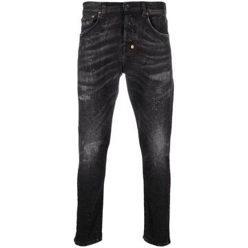 distressed-finish slim-fit jeans