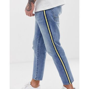 Jack & Jones Intelligence skater jeans in light blue with side taping