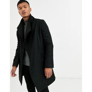 Religion funnel neck asymmetric overcoat in black