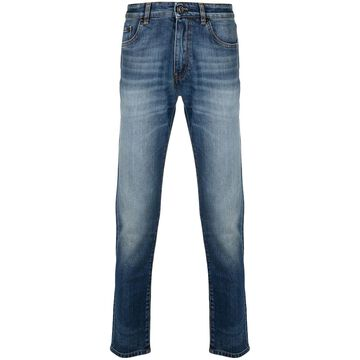 slim-cut faded jeans