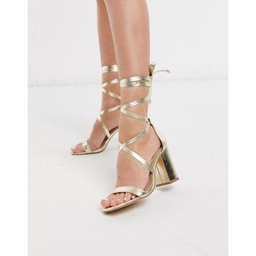 London Rebel tie leg heeled sandals in gold-Yellow