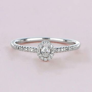1/5ct TDW Oval Shape Diamond Halo Ring in 10k Gold by De Couer