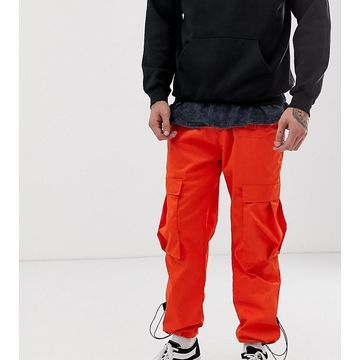 Reclaimed Vintage cargo pants in orange