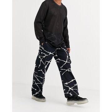 Jaded London cargo pants in black with print