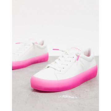 Skechers lace up sneakers in white with pink sole