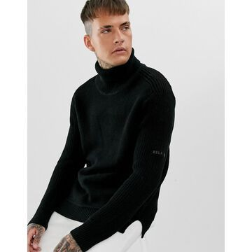 Religion chunky knit sweater with roll neck in black